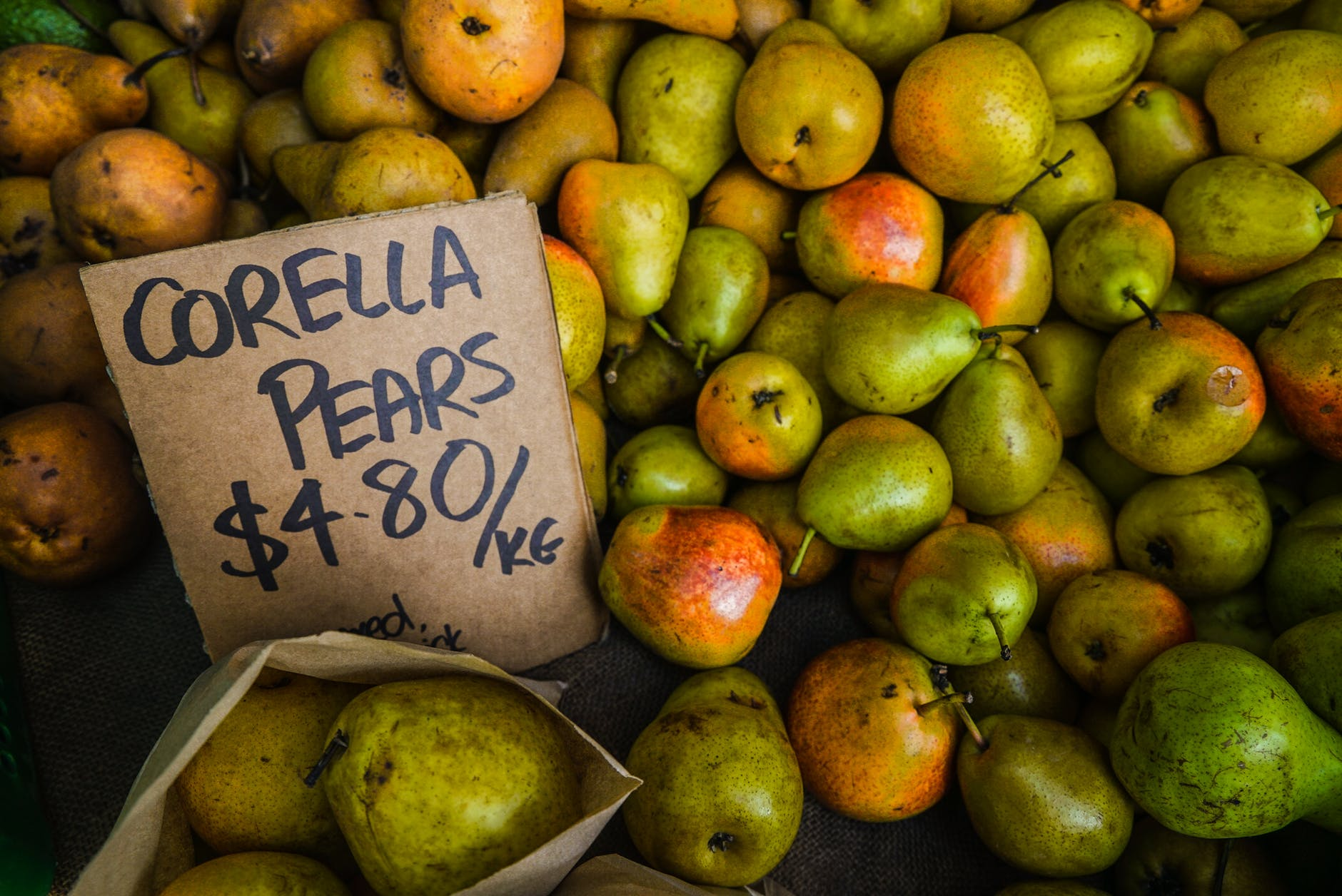 green and orange corella pear fruit lot